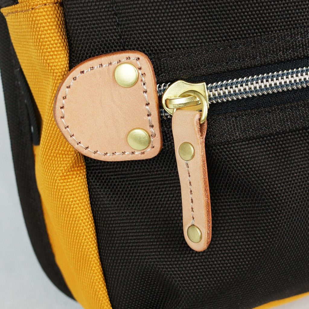 It is a photo of Unforgettable Harvest Label Cordura Sling Pack