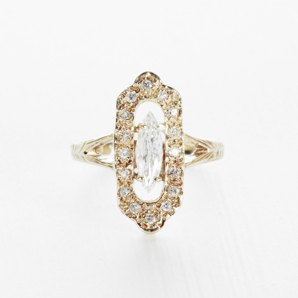 Antique - marquise shaped halo diamond ring in 14k yellow gold