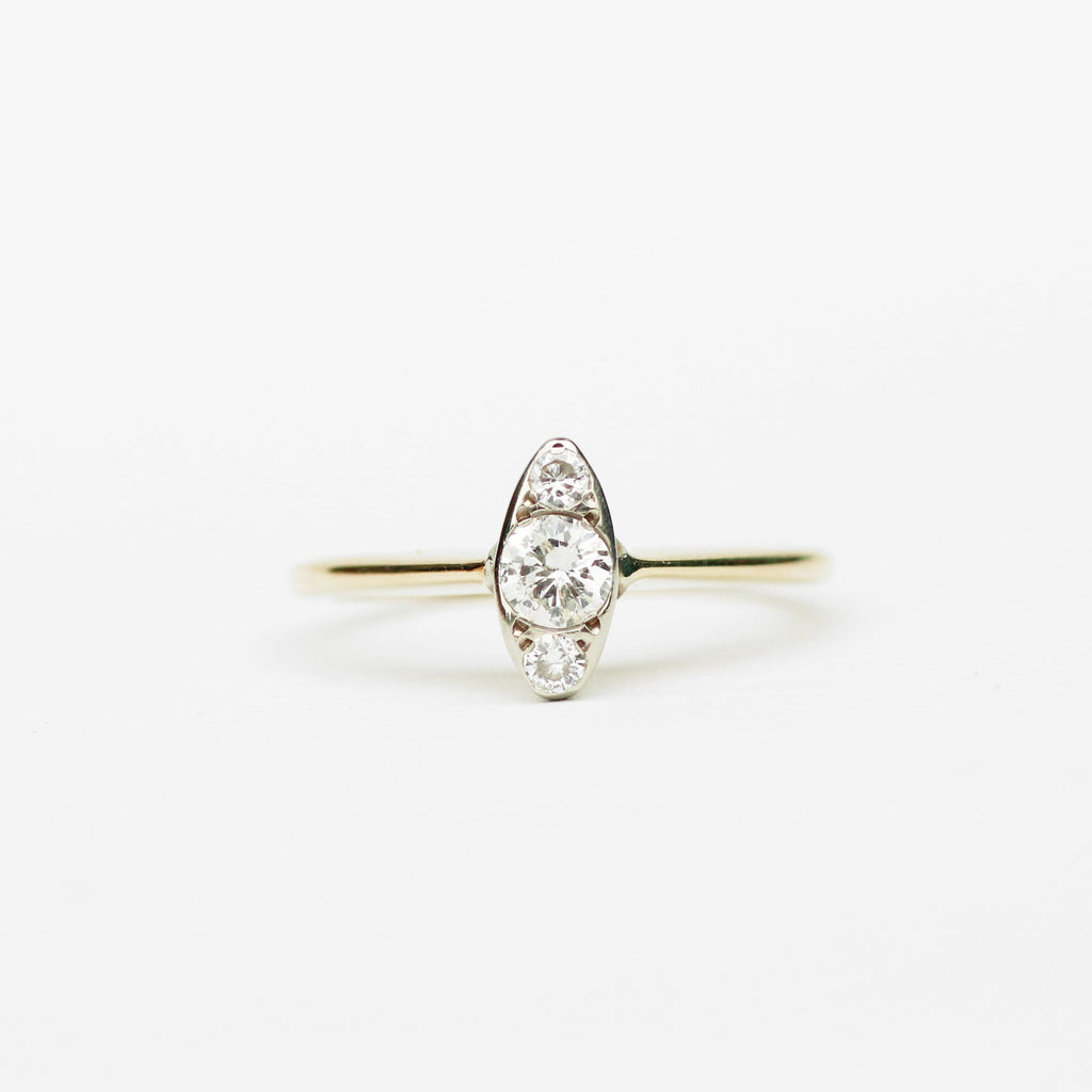 Antique - marquise shaped three diamond ring in 14k white and yellow gold