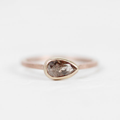 Pear Celestial Diamond in a Bezel Set Ring in yellow and rose gold - Ready to Size and Ship