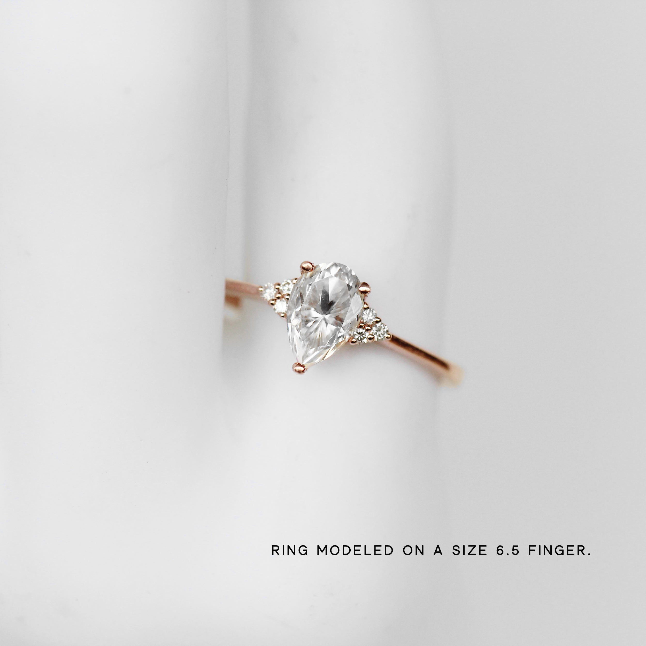 Imogene Ring with a Pear Moissanite and diamonds in your choice of gold