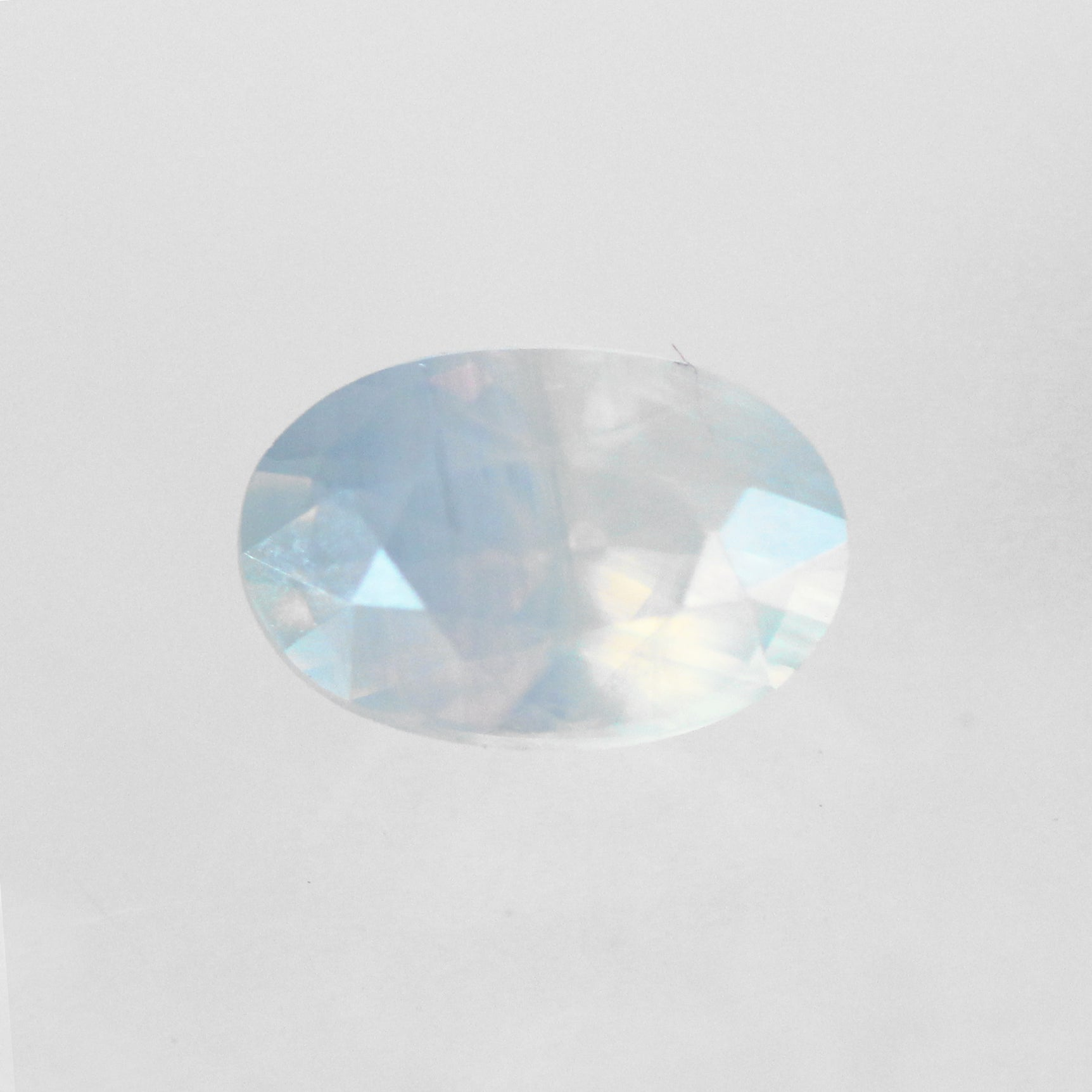 1.44 Carat Oval Opalescent Sapphire - Inventory Code OBS144 - Celestial Diamonds ® by Midwinter Co.