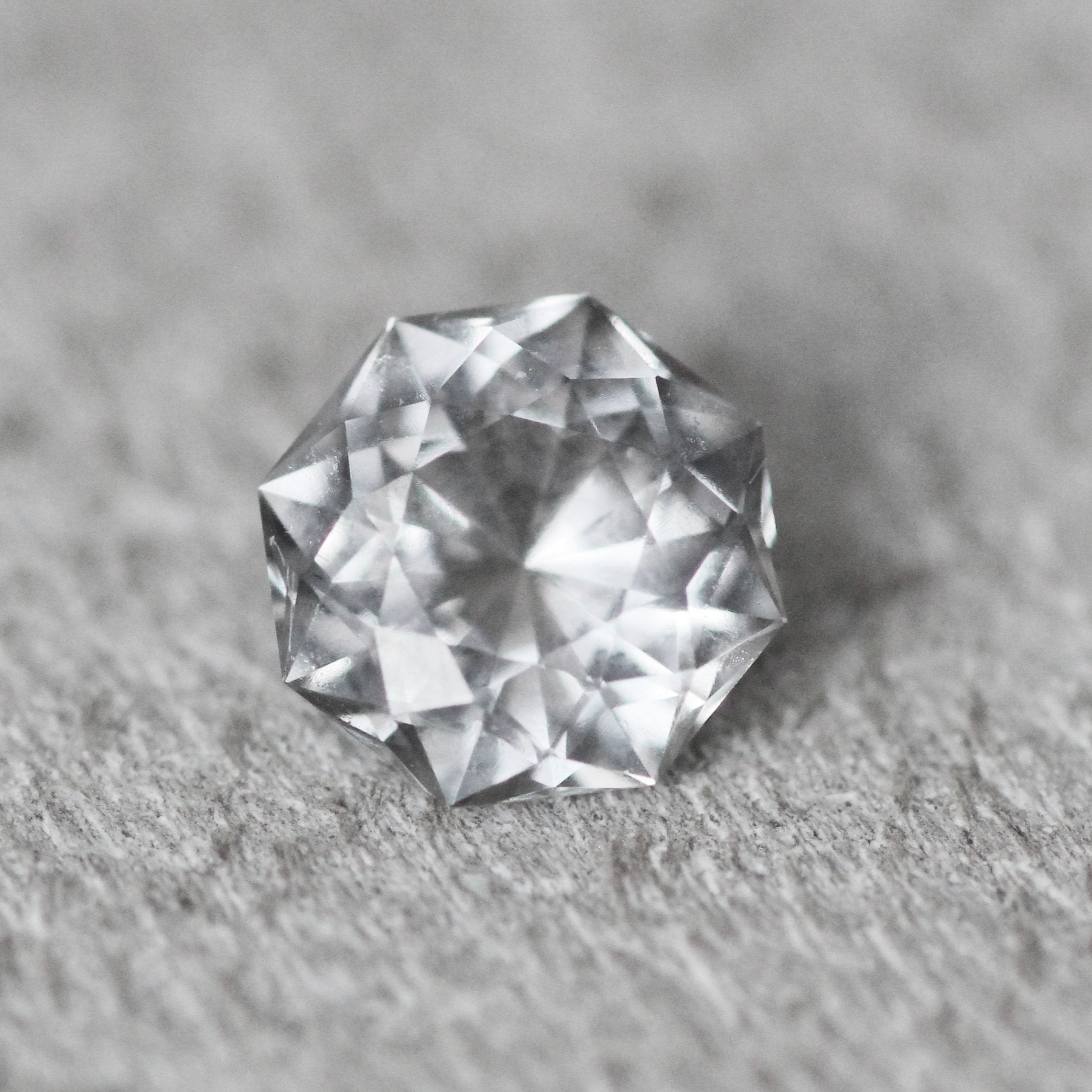ring platinum featuring a accented cushion round by cut halo brilliant diamond pin octagon