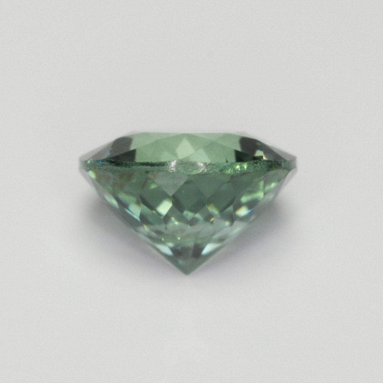 .61 carat round green teal sapphire - custom work - inventory code LGRS61 - Midwinter Co. Alternative Bridal Rings and Modern Fine Jewelry