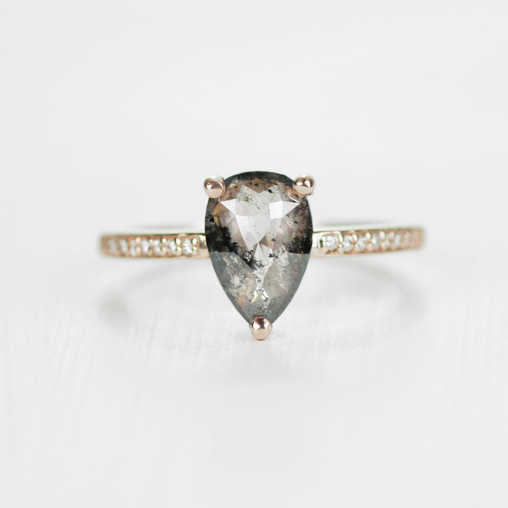 Imani with a 1.5ct Clear and Black Pear Celestial Diamond in 14k rose gold - ready to size and ship