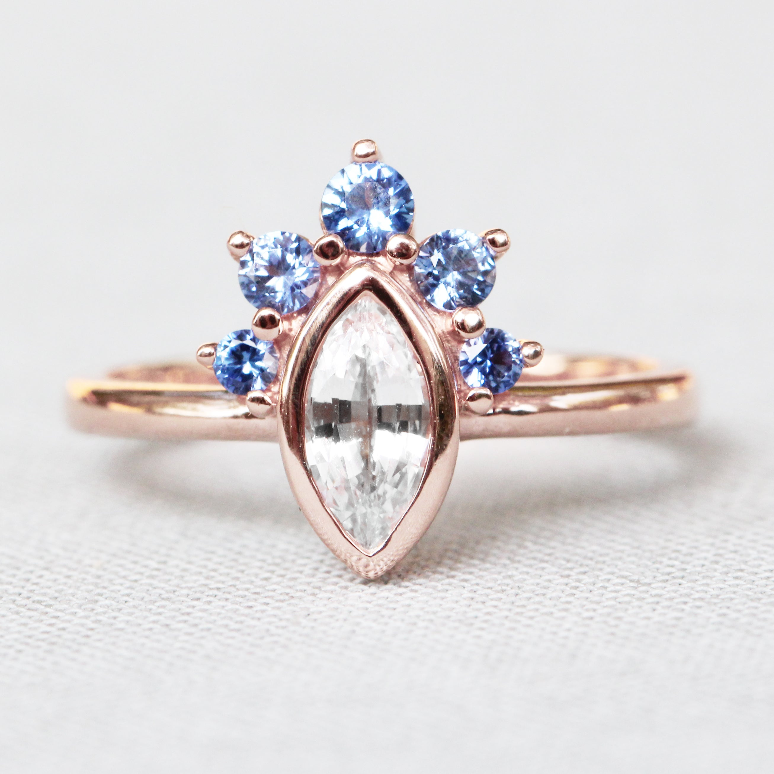 Ashlyn Ring with White Sapphire and Ceylon Blue Sapphires in 14k Rose Gold
