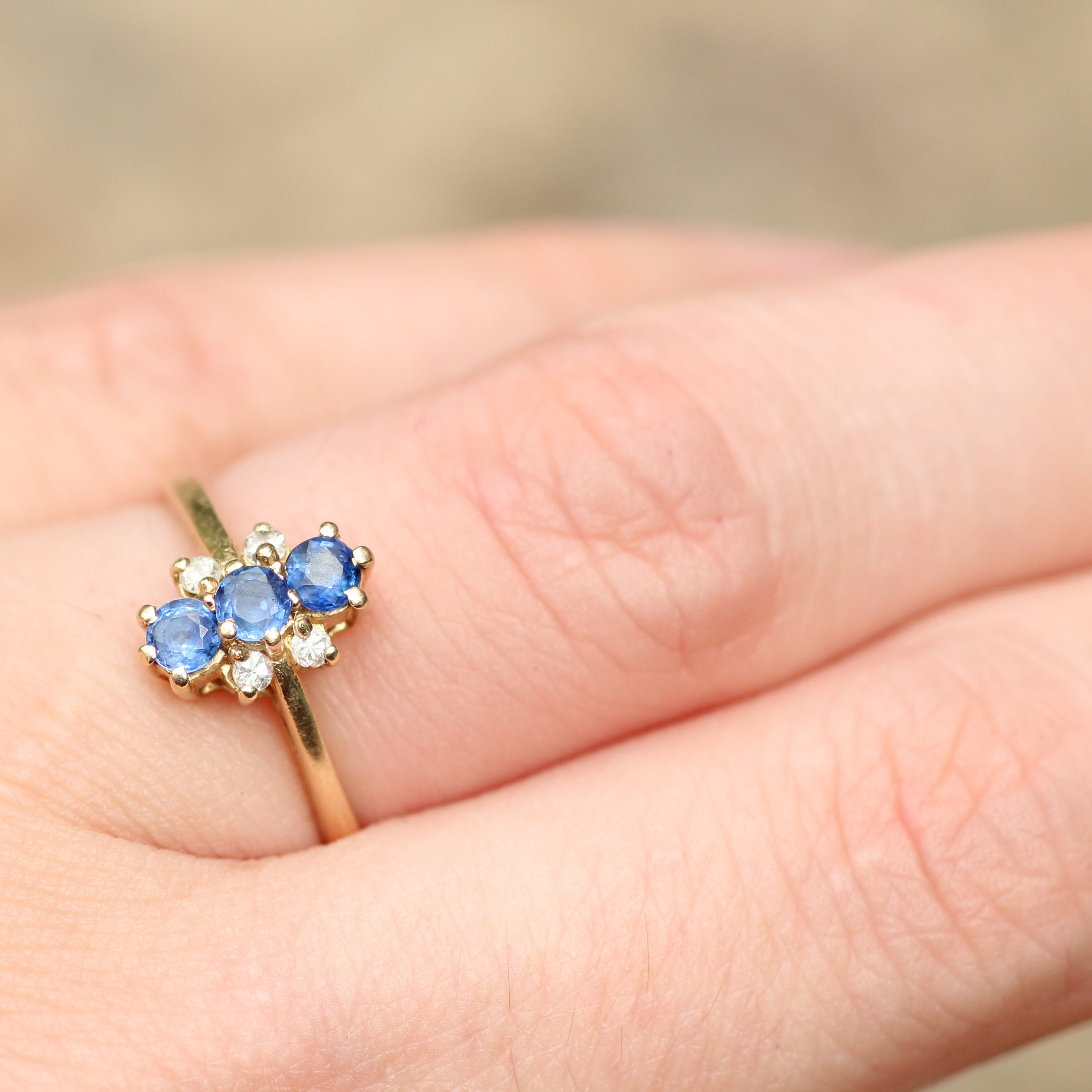 Vintage - Three sapphire and four diamond ring in 14k yellow gold