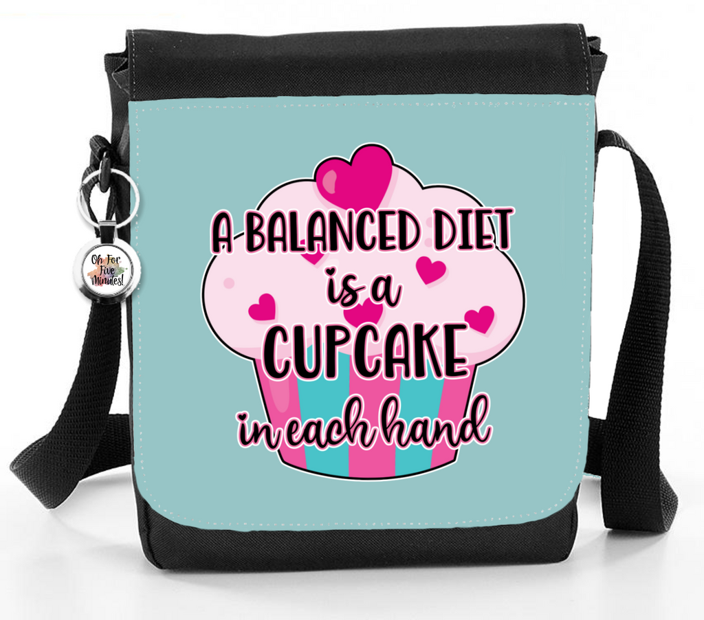 A Balanced Diet Is A Cupcake In Each Hand (Cyan) - Reporter Bag