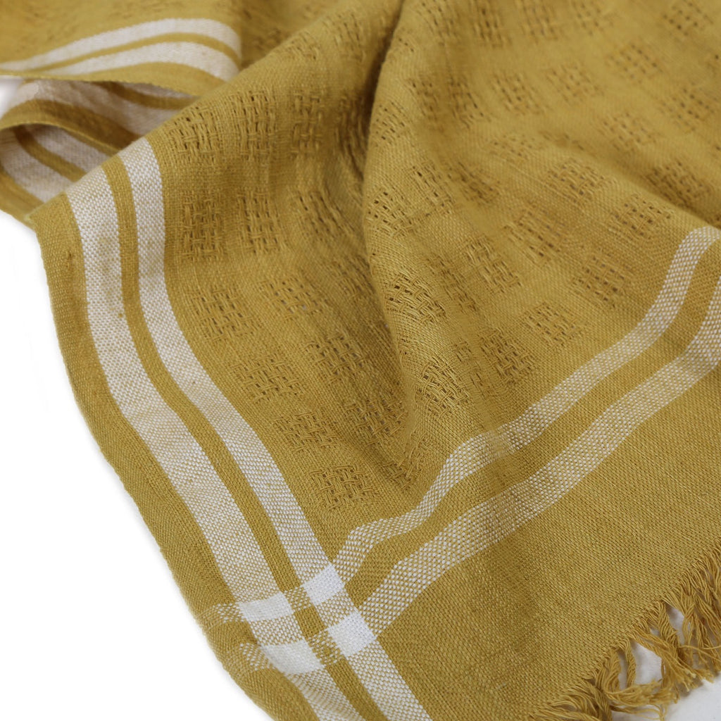 100% cotton towel. machine wash separately first - under 30degrees - mustard. 80 x 180cm