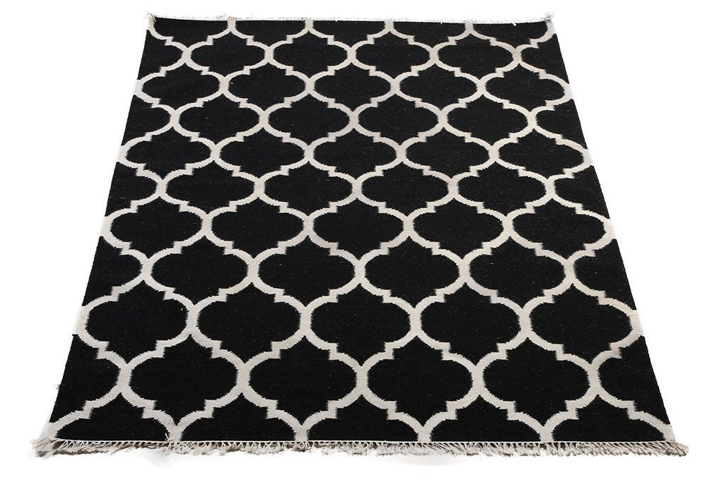 hand woven flat-weave dhurrie style, black with white mogul design