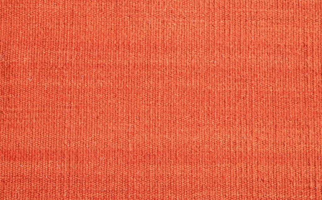 hand woven thinner flat-weave dhurrie style, abrush bright orange