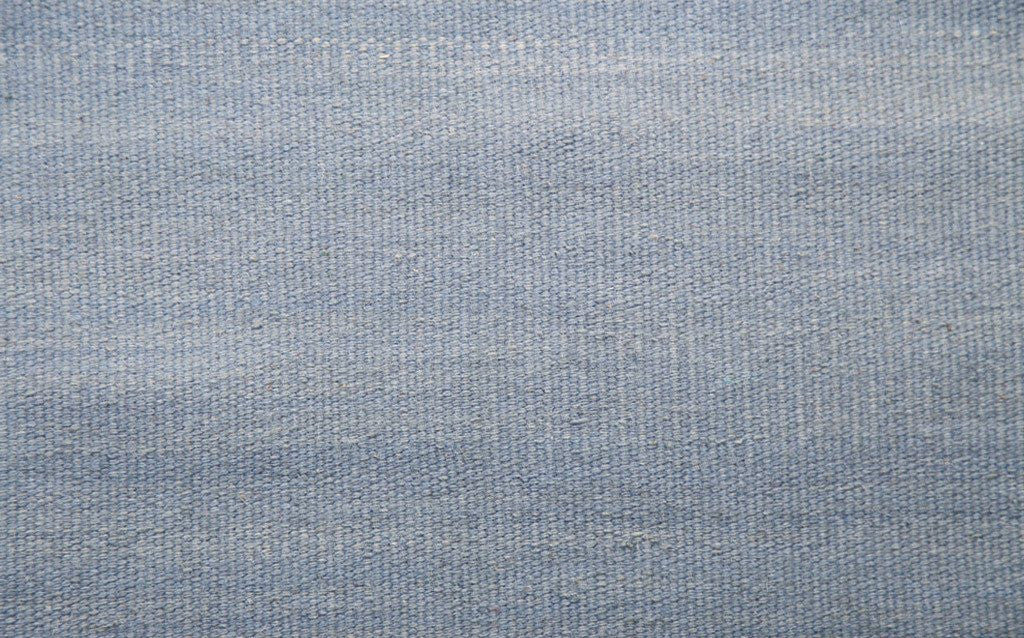 hand woven thinner flat-weave dhurrie style, abrush light blue colour