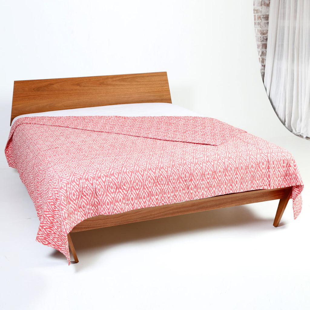red planet ikat cotton quilt