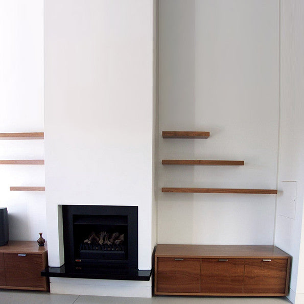 custom floating shelves & matching cabinets