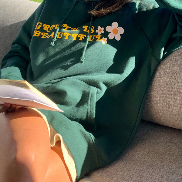 girl reading a book compound effect wearing an oversized green hoodie