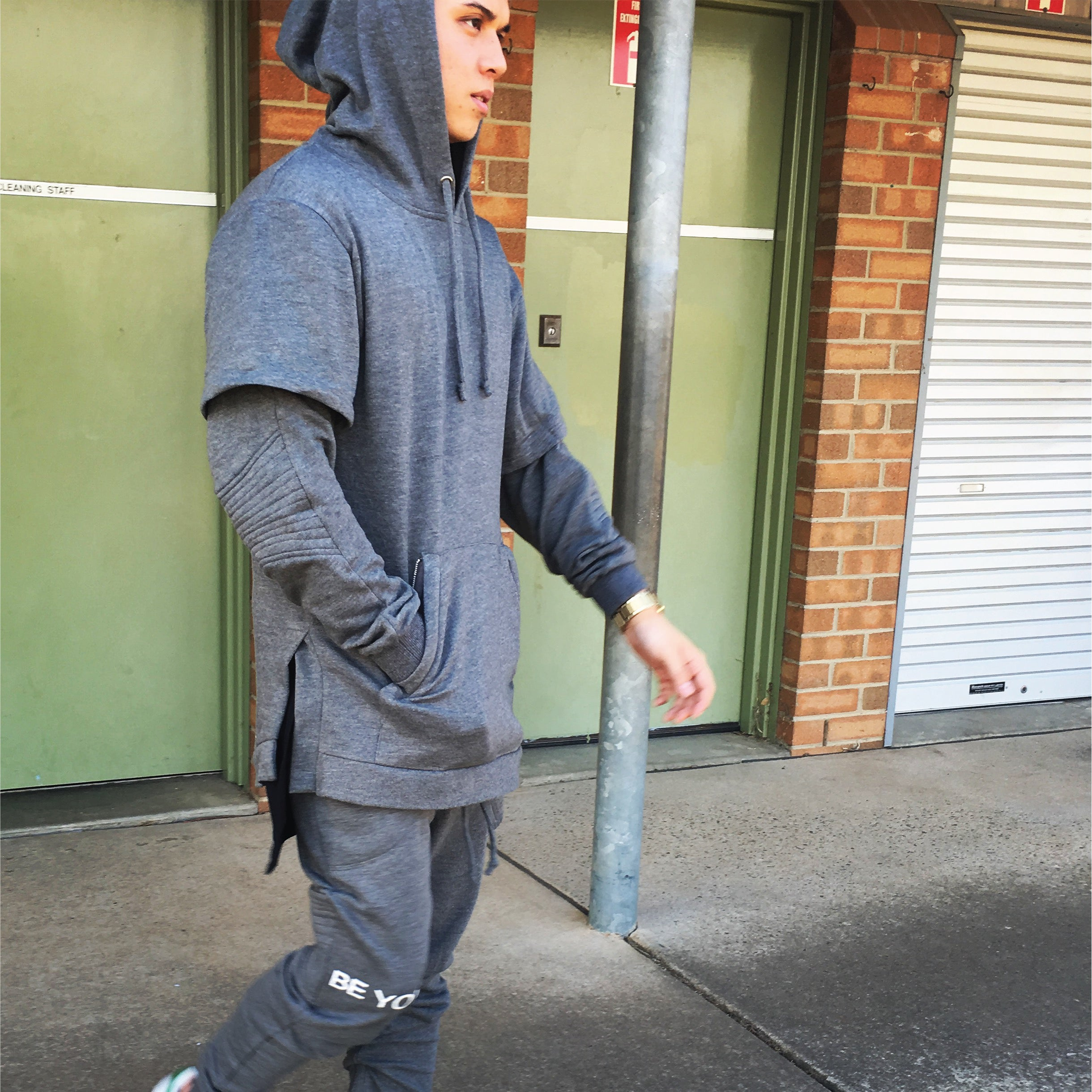 grey hood and track pants