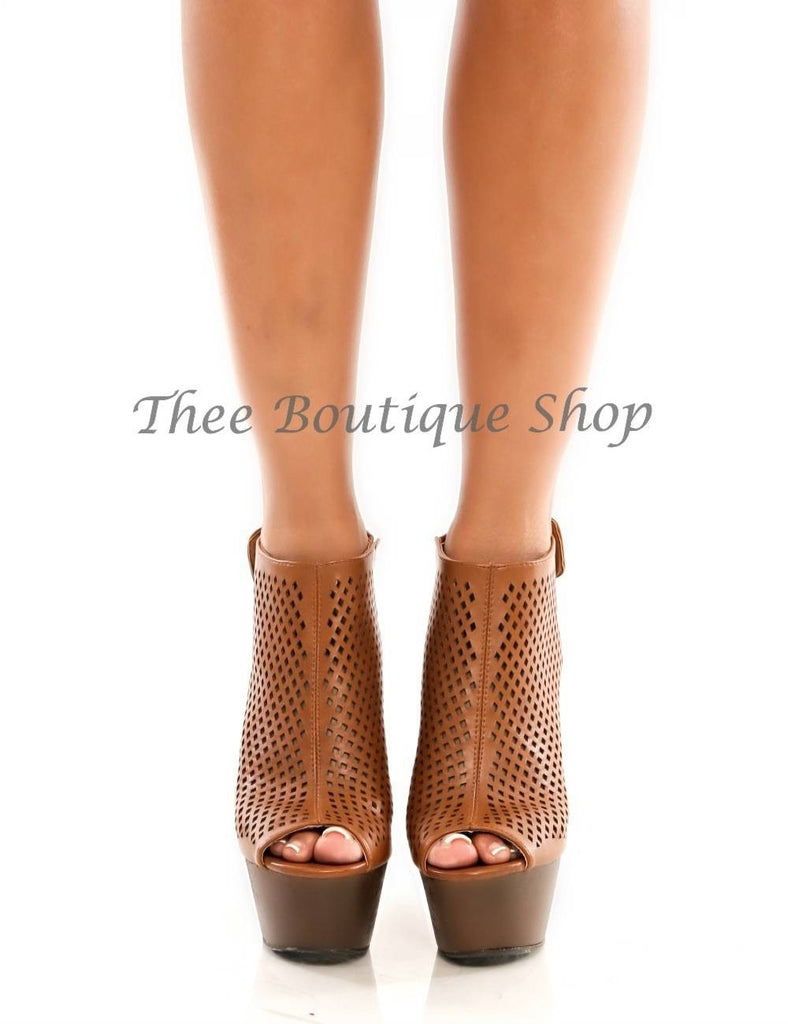 The Eva-Perforated Wedge Heel