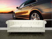 Rear-side view of a luxury car on sunset Wall Mural-Transportation-Eazywallz