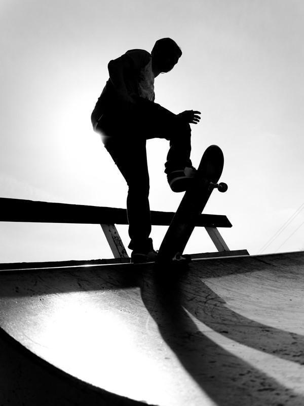 Silhouette of a young skateboarder Wall Mural-Black & White,Sports,Urban-Eazywallz