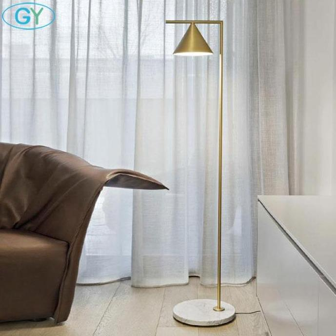 gold-floor-lamp-behind-a-chair-Zavato-Home