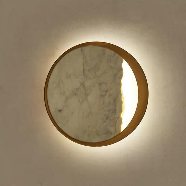 circular-marble-wall-lamp-lit-up-Zavato-Home