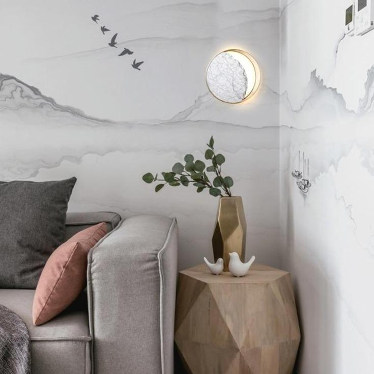 circular-marble-and-gold-wall-lamp-displayed-in-a-living-area-Zavato-Home