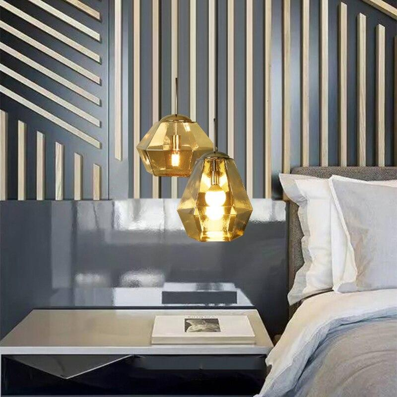 two-gold-lava-pendant-light-over-a-bedside-table-Zavato-Home