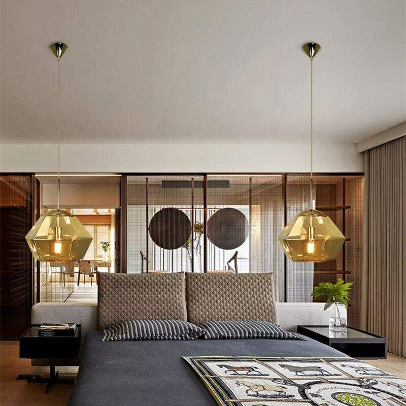 two-gold-lava-pendant-lamp-over-a-bed-Zavato-Home