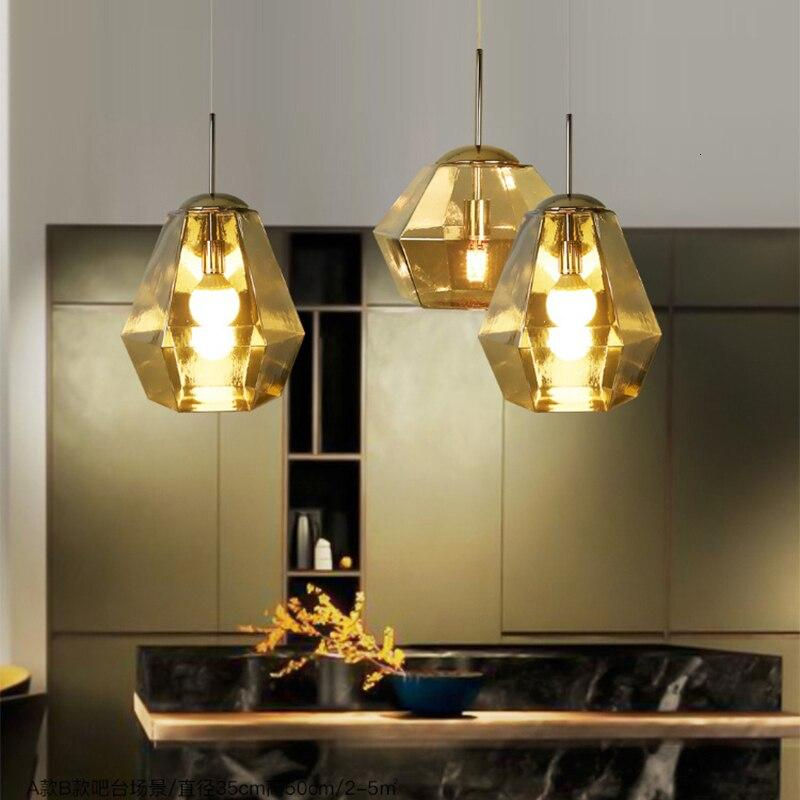 three-gold-lava-lamp-over-a-counter-Zavato-Home