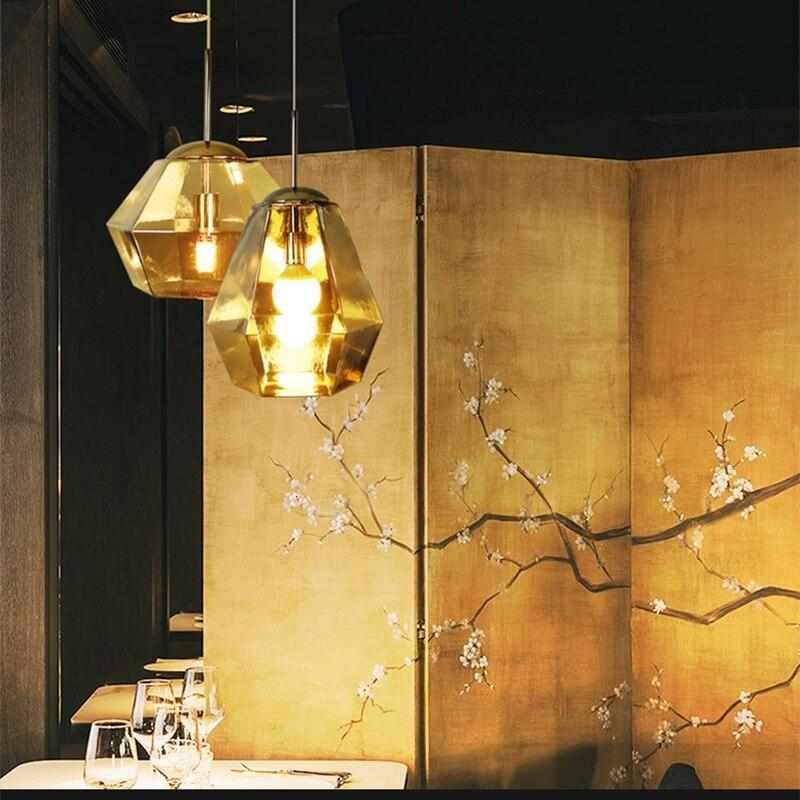 two-gold-pendant-lamp-in-a-restaurant-Zavato-Home