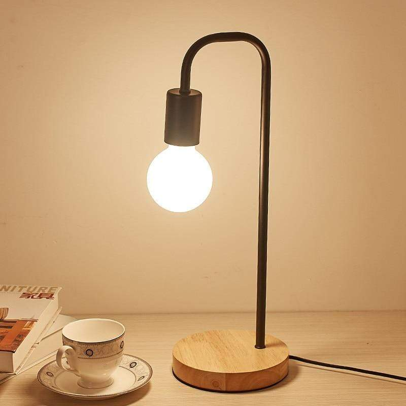 black-shadeless-table-lamp-displayed-with-cup-and-saucer-Zavato-Home