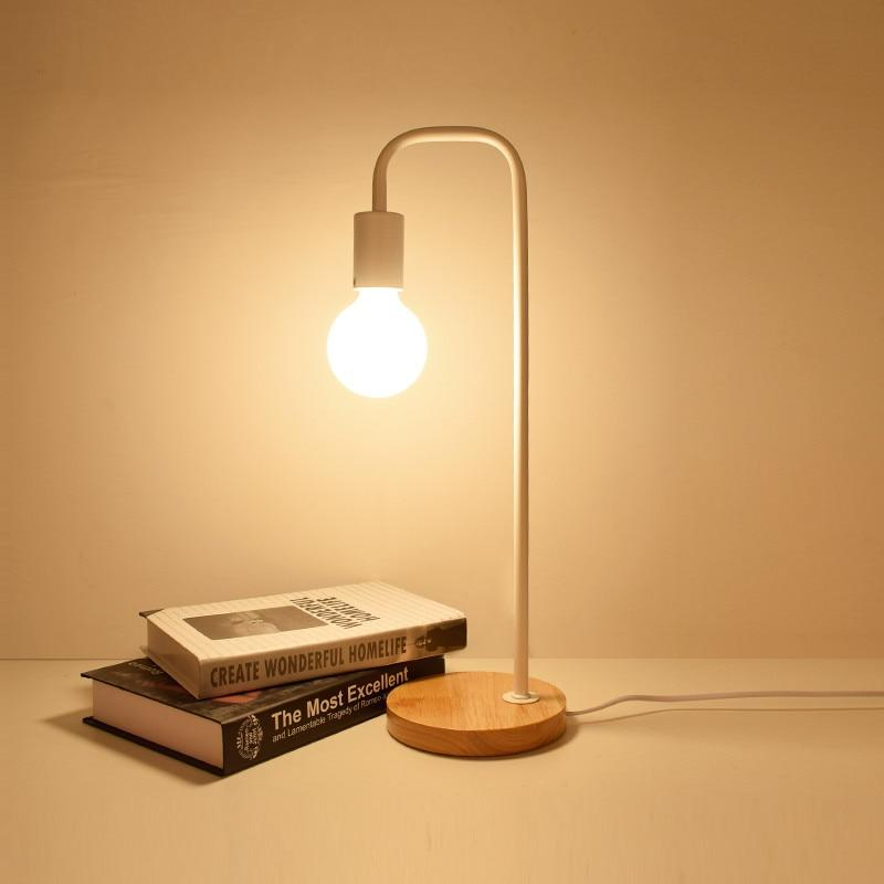 white-shadeless-table-lamp-with-books-Zavato-Home