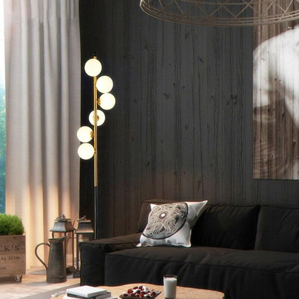 six-light-floor-lamp-near-a-couch-Zavato-Home