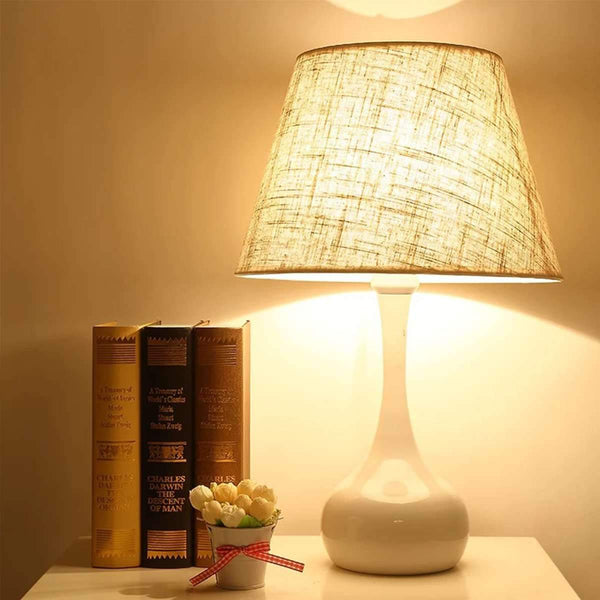 on-table-lamp-in-display-with-books-Zavato-Home