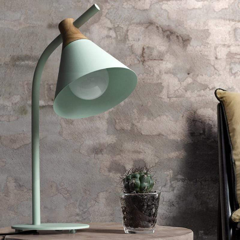 green-desk-lamp-on-a-bedside-table-Zavato-Home