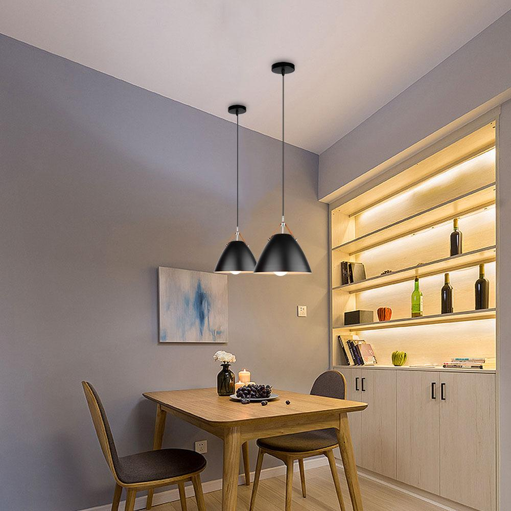 two-black-pendant-lighting-over-a-dining-table-Zavato-Home
