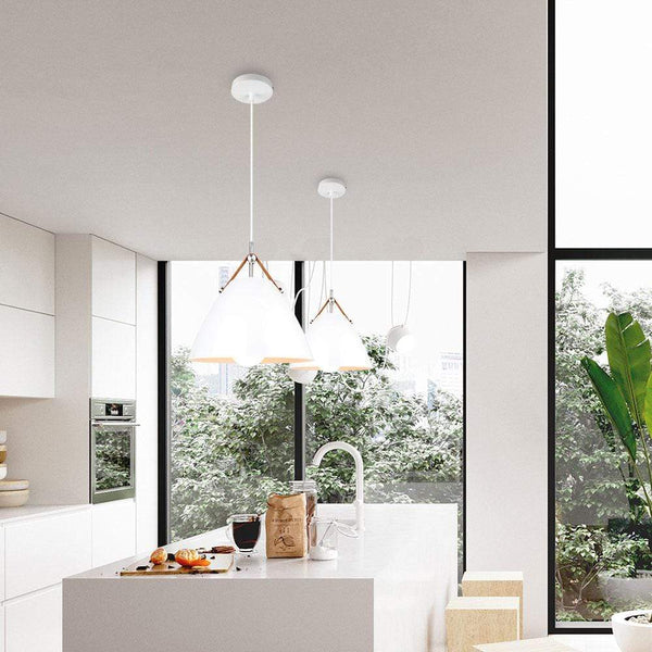 two-white-pendant-light-over-a-kitchen-counter-Zavato-Home