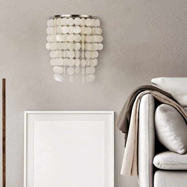 seashell-wall-lamp-near-a-sofa-Zavato-Home