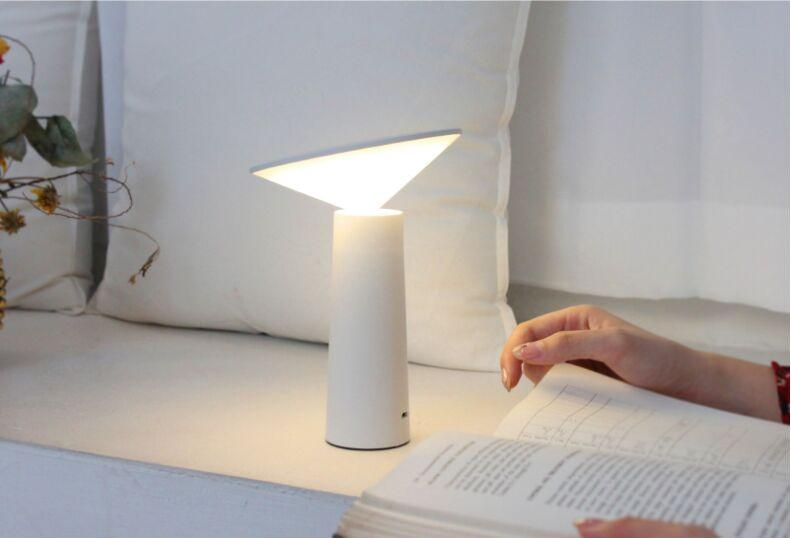 reading-a-book-with-an-LED-USB-desk-lamp-Zavato-Home