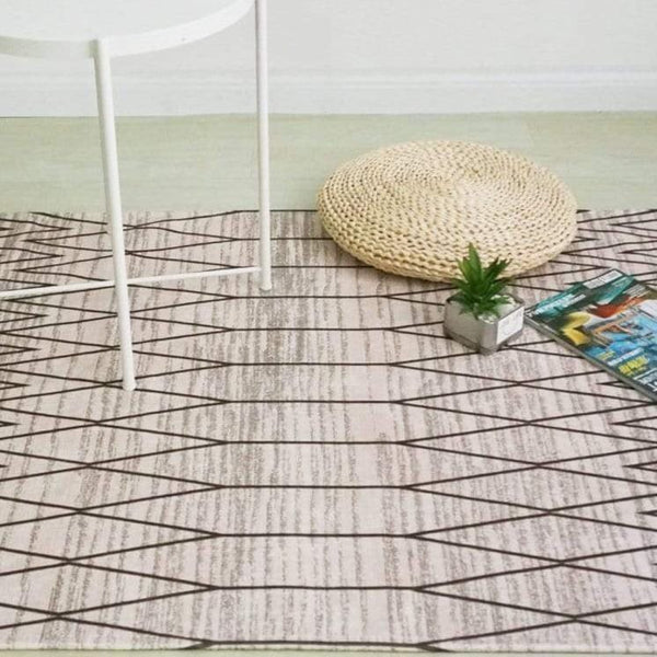 modern-rug-under-a-chair-Zavato-Home