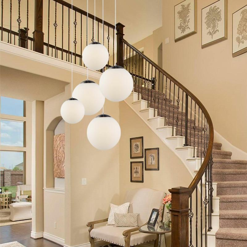 frosted-hanging-light-near-staircase-Zavato-Home