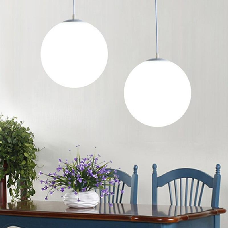 two-frosted-hanging-lights-over-a-table-Zavato-Home