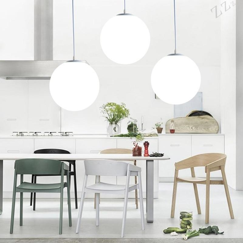 frosted-white-glass-pendant-light-in-the-kitchen-Zavato-Home