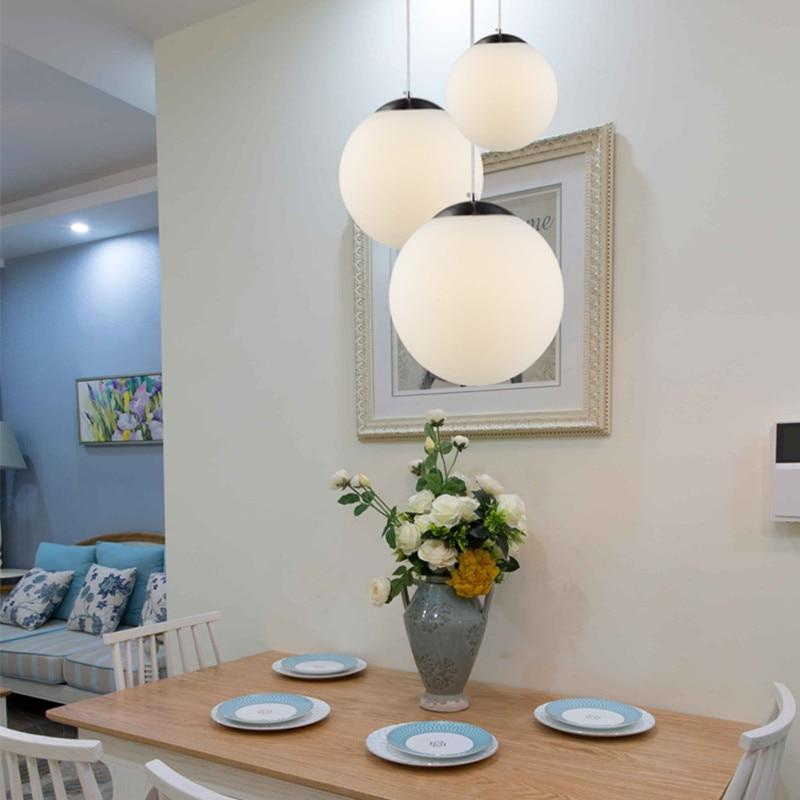 frosted-white-glass-pendant-light-over-table-Zavato-Home
