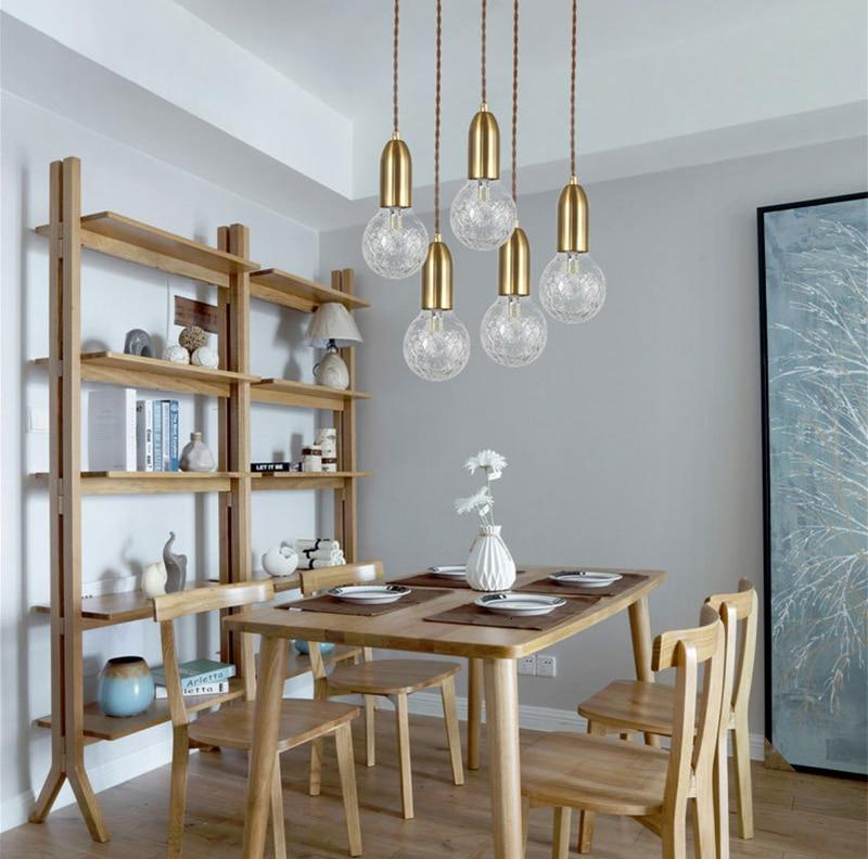 multiple-glass-pendant-lamp-over-a-table-Zavato-Home