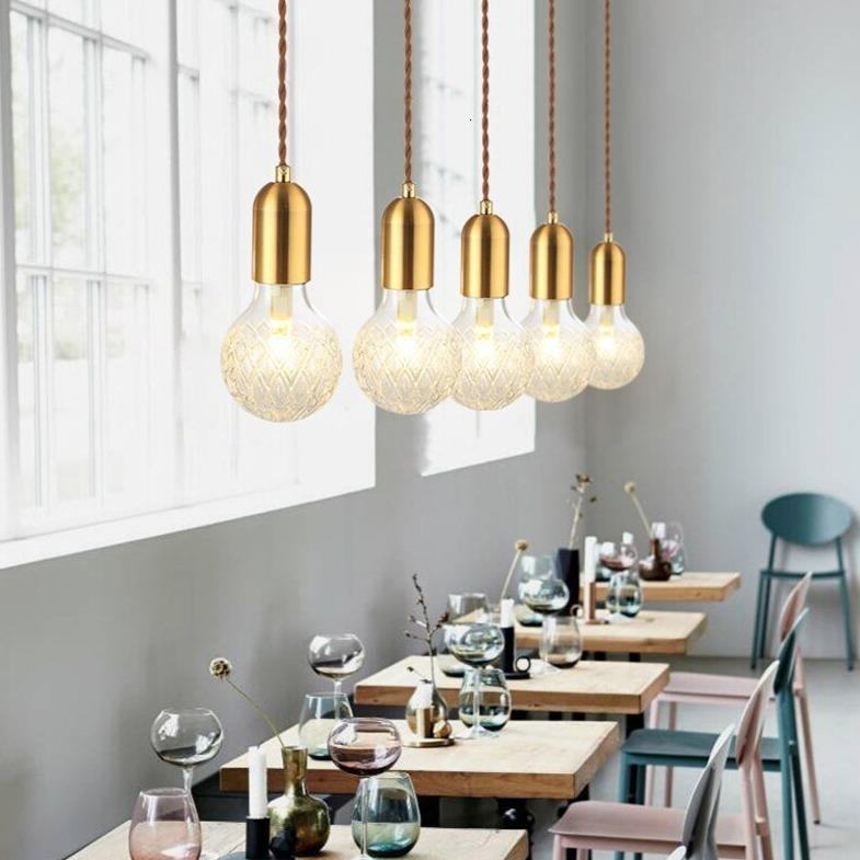 multiple-pendant-lamps-over-tables-Zavato-Home