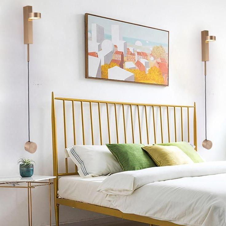 two-gold-dimmable-wall-sconce-in-a-bedrool-wall-Zavato-Home