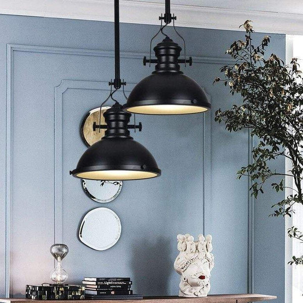 two-black-pendant-light-over-a-table-Zavato-Home