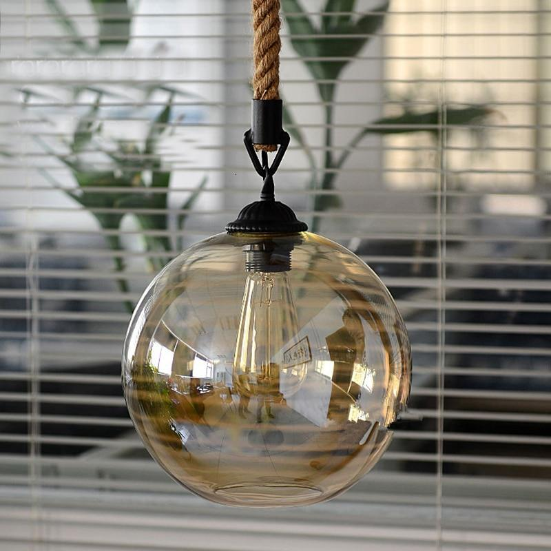 amber-round-glass-pendant-lamp-hanging-using-a-hemp-cord-Zavato-Home