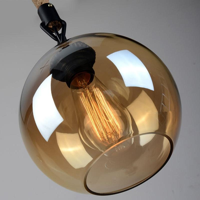 close-up-of-round-glass-pendant-lamp-Zavato-Home